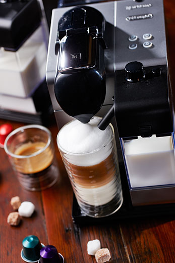 latte preparation with nespresso new machine, photography Vadim Daniel