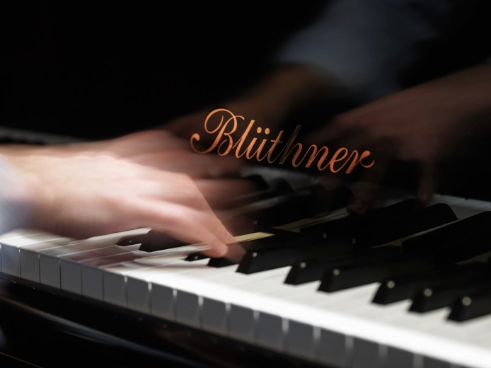 action photography, hand and piano. Commercial advertising photography by Vadim Daniel